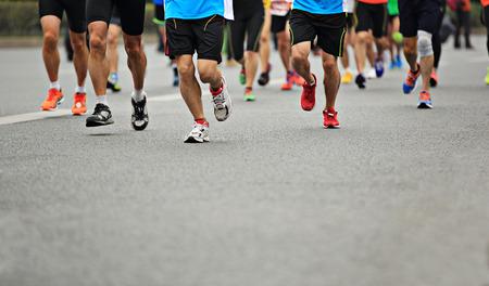 marathon athlete running on city road 写真素材