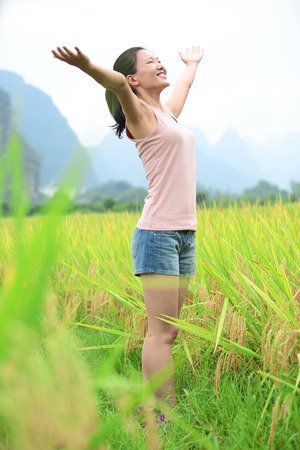 open arms: young asian woman open arms at paddy field