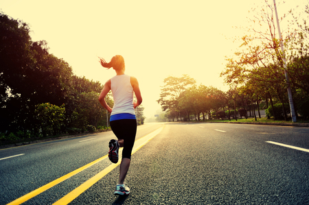 slim woman: Runner athlete running at road.