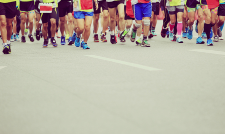 training shoes: Marathon runners running on city road
