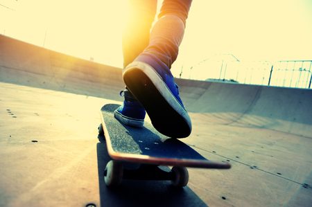 skateboard shoes: skateboarder skating   at skatepark Stock Photo