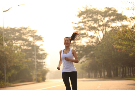 outdoor exercise: Runner athlete running at road.