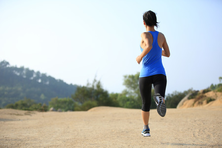 japanese woman: young woman runner legs running on mountain trail