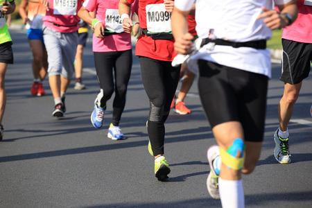 marathon athlete running on city road
