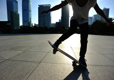 animal practice: skateboarder skateboarding at sunrise city Stock Photo