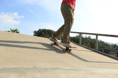 ramp: skateboarder legs skateboarding at skatepark ramp