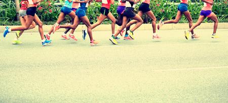 Marathon running race, people feet on city road Banco de Imagens