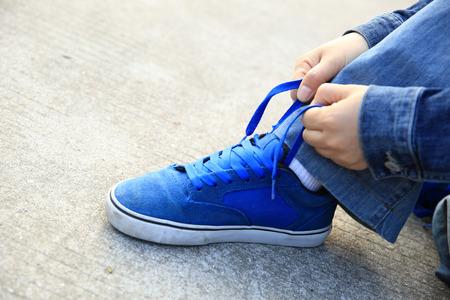 shoelace: skateboarder hands tying shoelace