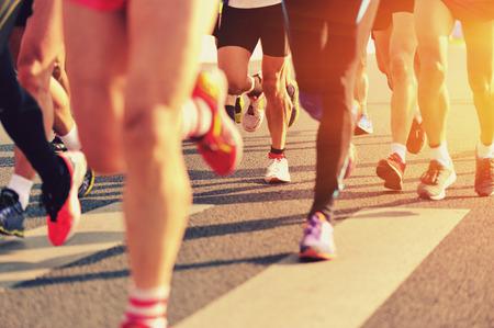 marathon runners running on city road Foto de archivo