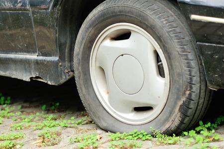 flat tire: flat tire on car wheel Stock Photo