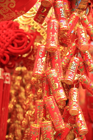 good wishes: chinese red lantern and fake firecrackers,words means: best wishes and good luck for the coming chinese new year Stock Photo