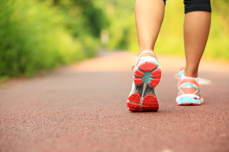 piernas: young fitness woman hiker legs at forest trail