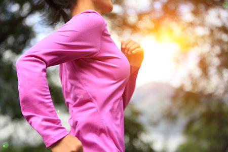 sport training: Runner athlete running on road. woman fitness sunrise jogging workout wellness concept.