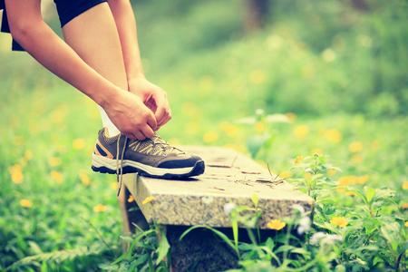 shoelace: woman tying shoelace outdoo
