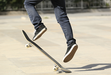 skateboard shoes: young boy skateboarding in the city Stock Photo