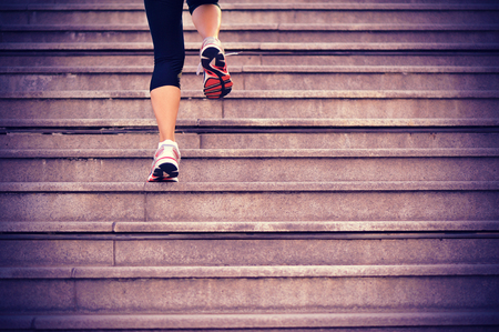 woman stairs: sports woman  running up on stone stairs