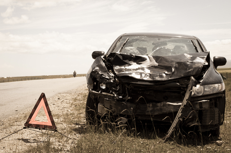 fender bender: accident car and warning triangle beside road Stock Photo