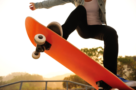 woman skateboarding at skatepark Stock Photo