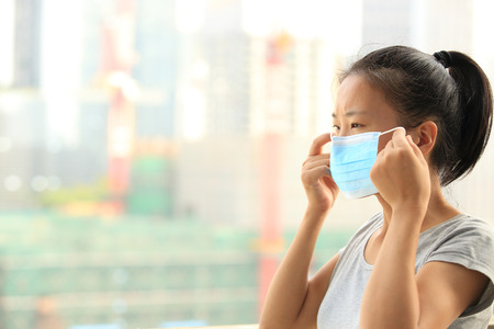 safety mask: asian woman wear face mask in city