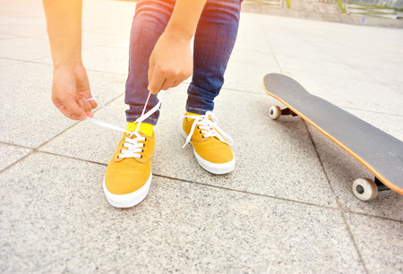 shoelace: skateboarder woman tying shoelace