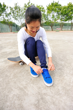 skateboard shoes: skateboarder woman trying new skateboard shoes