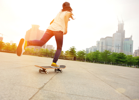 skateboard shoes: skateboarder woman skateboarding at city