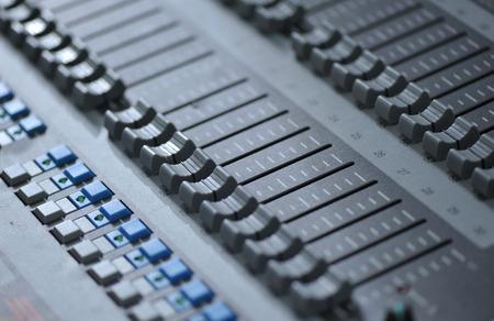 adjuster: Closeup of professional sound mixer buttons.
