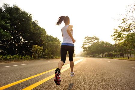 girl jogging: Runner athlete running at road.