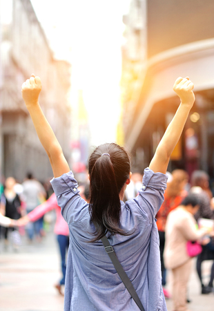 cheering woman open arms at shopping street