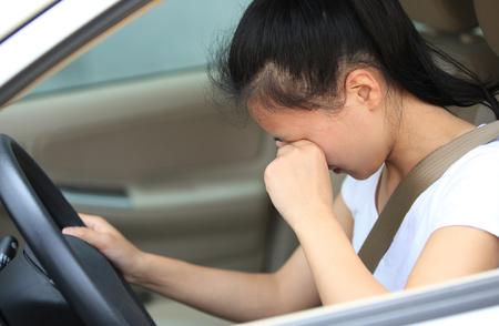female driver: Sad woman driver sit in car.
