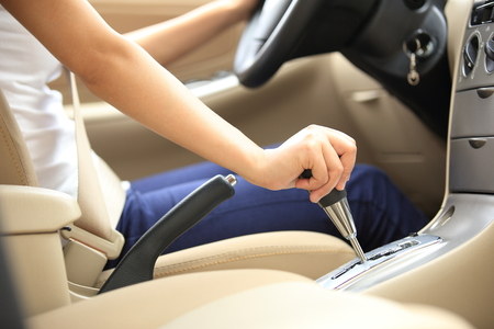 shifting: woman driver shifting the gear stick and driving a car Stock Photo
