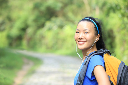 forest trail: Hiking woman on forest trail Stock Photo
