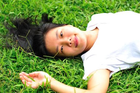 woman laying down: beautiful woman laying down in grass