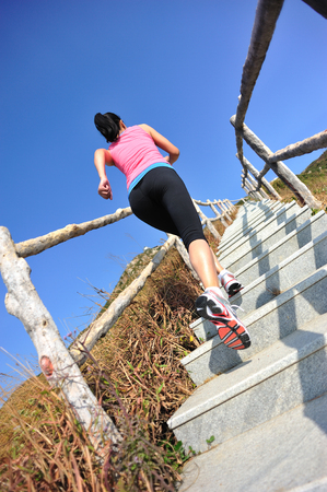 outdoor activities: healthy lifestyle sports woman running on mountain stairs