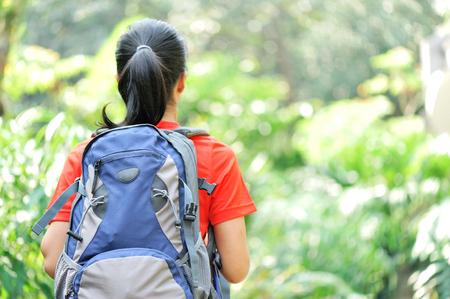 Young asain woman hiker in jungle.