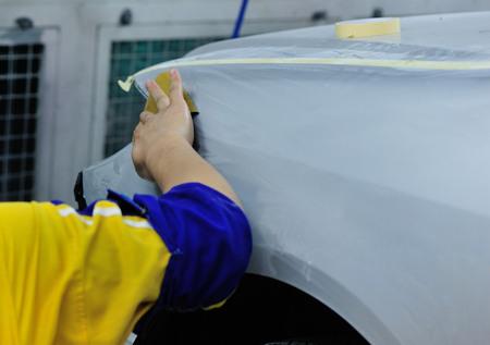 body work: Car body work, man repair car in garage Stock Photo