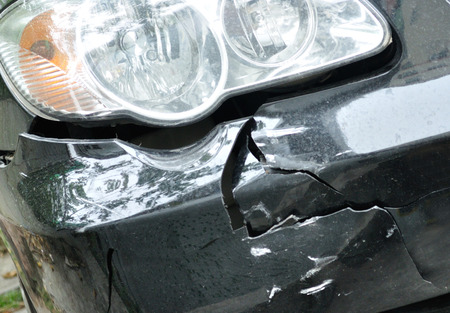 front bumper: a car has a dented front bumper after accident