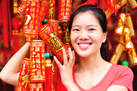 gung: young woman wishing a happy chinese new year