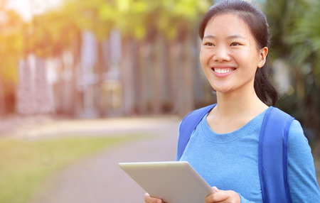 colleges: adult college student use tablet pc at campus