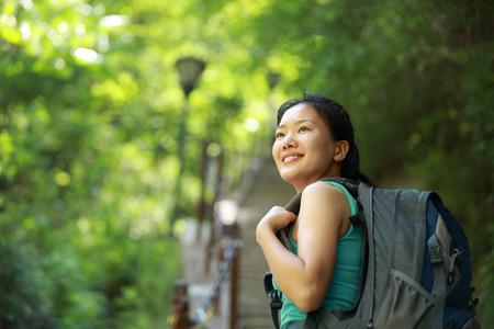 asian woman hiker climb mountain Stock Photo
