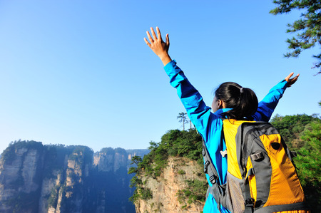 trekker: woman backpacker at zhangjiajie national forest park,china