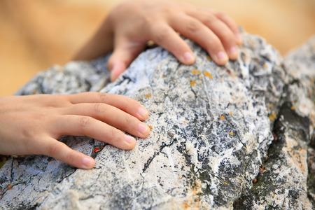 grabbing: hands grabbing  mountain rock