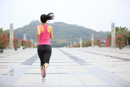 healthy people: healthy lifestyle sports woman running on city Stock Photo