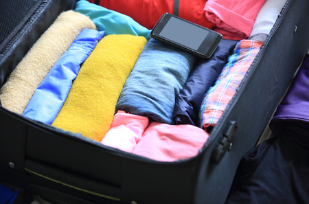 packing suitcase: packing for a new journey