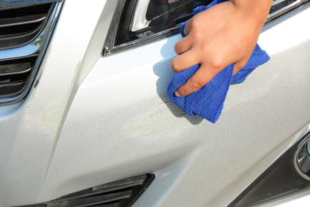 front bumper: cleaning scratches at front bumper Stock Photo