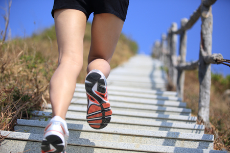 woman stairs: woman running up on mountain stairs