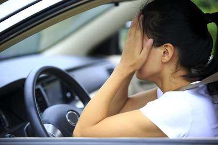 sad woman  in car