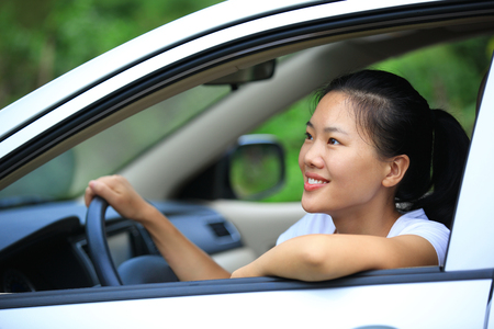 woman driving car: happy woman driver sit in car Stock Photo