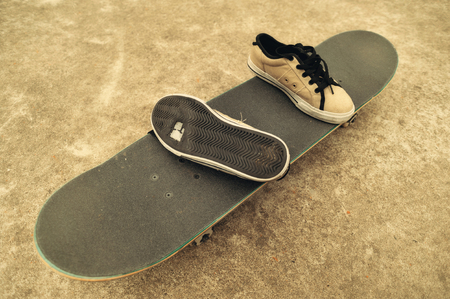 trick or tread: worn sneakers on skateboard