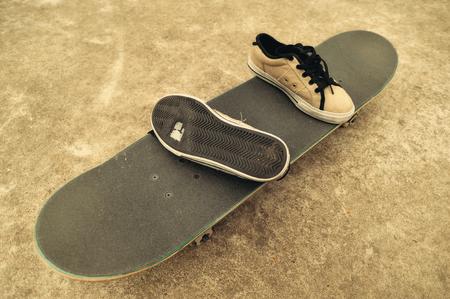 trick or tread: worn sneakers on skateboard